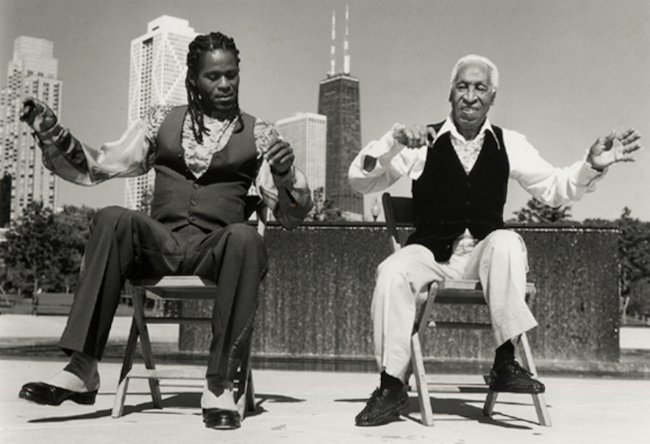 """Reggio """"The Hoofer"""" McLaughlin (left) chair dancing with vaudeville legend Ernest """"Brownie"""" Brown on Chicago's lakefront"""