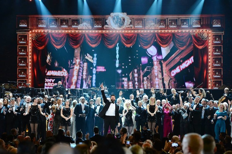 2014 Tony Awards host Hugh Jackman, center, onstage during the ceremony in New York City