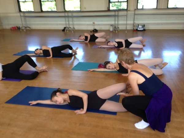Julie Pappas-Smith teaches a floor-barre class at the Marblehead School of Ballet's Summer Intensive