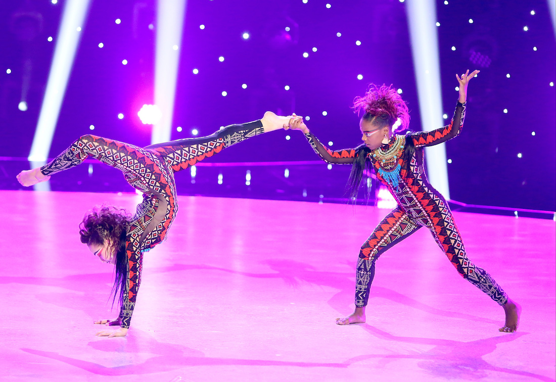 Top 10 contestants Ruby and Jordan perform an African jazz routine to