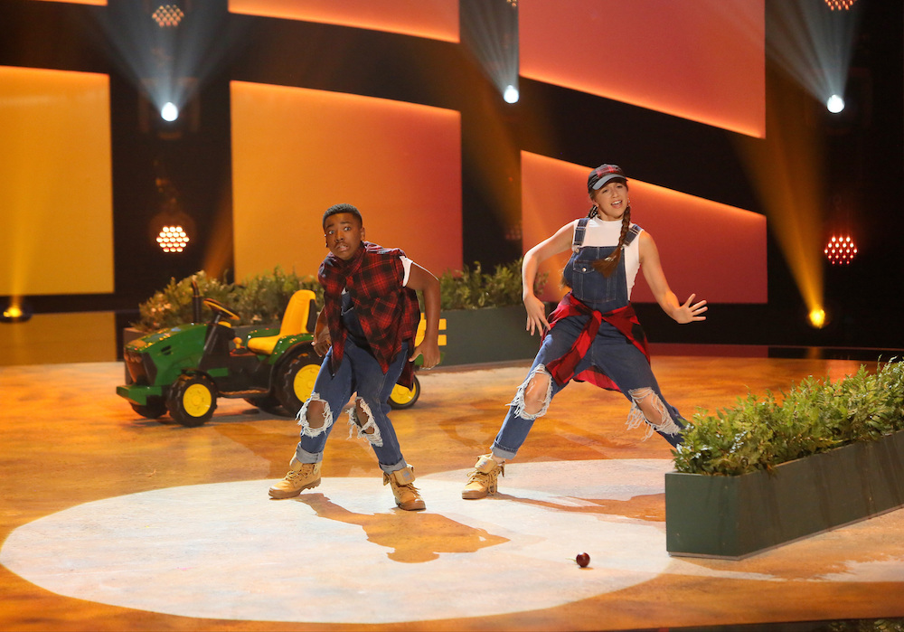 Top 10 contestants Kida Burns and Tate McRae perform a Hip-Hop routine to